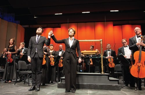 Music Director Laura Jackson and Composer Zhou Tian bow for a standing ovation after the World Premiere performance of Transcend by the Reno Phil on April 27, 2019. Photo by David Calvert.